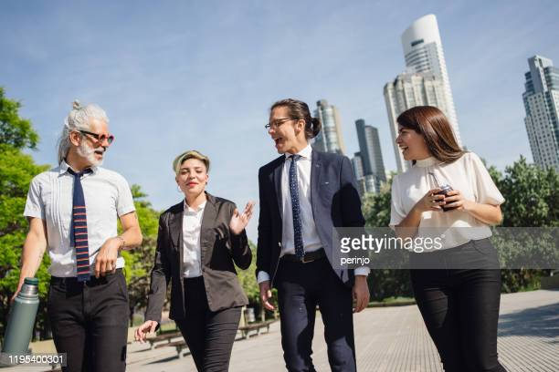 group of modern business people outdoors - businesswear stock pictures, royalty-free photos & images