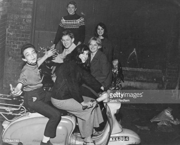 A group of mods posing on their scooters outside The Scene club in Soho London circa 1964