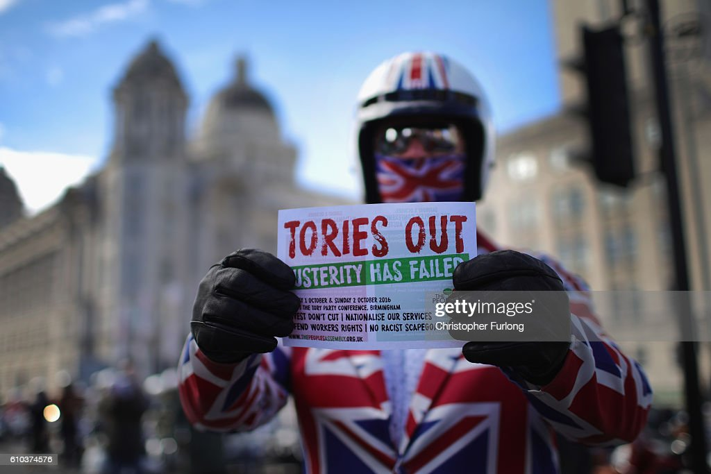 A group of mods show their support for nurses and NHS workers taking part in a demonstration to save Liverpool Women's Hospital outside the Labour party conference on September 25, 2016 in Liverpool, England. Party leader Jeremy Corbyn is rallying members hoping to re-unite the party after being re-elected leader yesterday.
