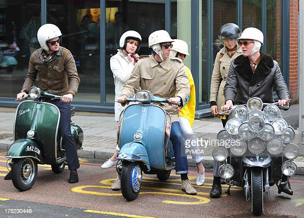 A group of mods with their scooters in London UK 2010