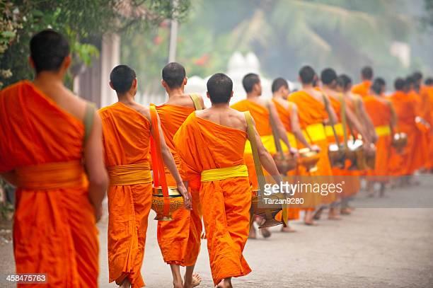 Group of monks walking in street, Laung Prabang, Laos