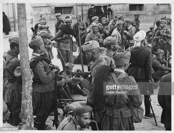 A group of Moorish troops who are fighting with the antirepublican nationalists rest in a suburb of Madrid after a victorious encounter Their forces...