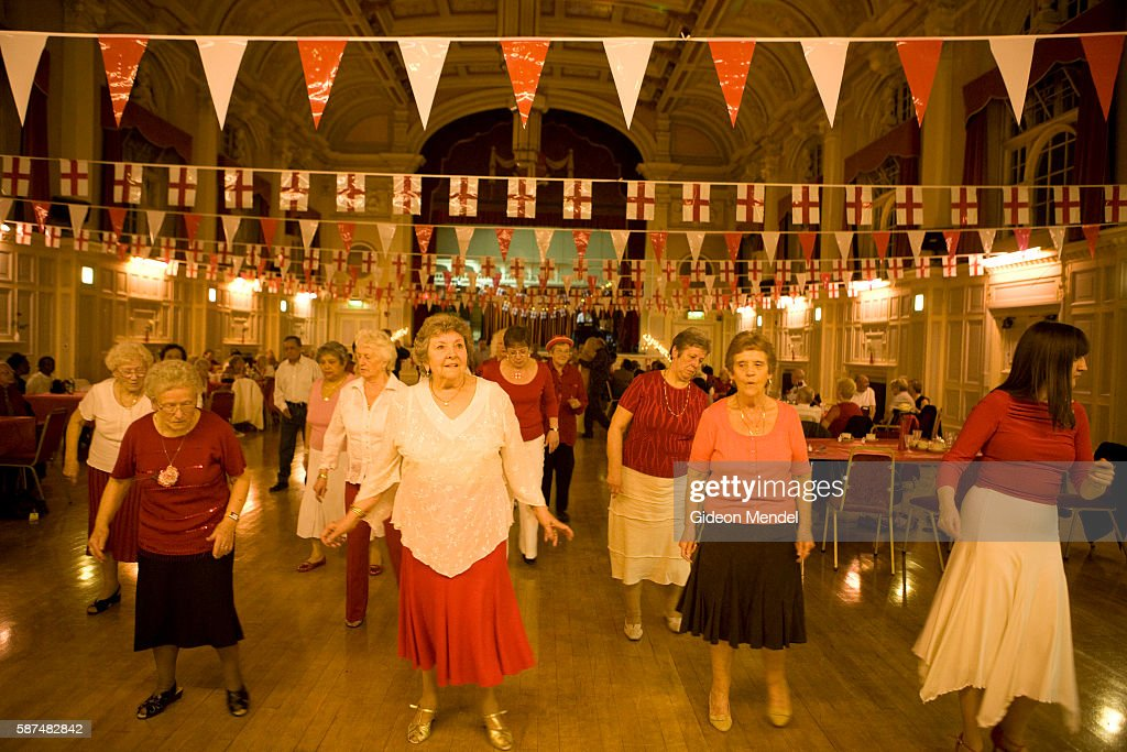 A Group Of Mostly Elderley People Enjoy Traditional English Tea Dance In The Newham Town