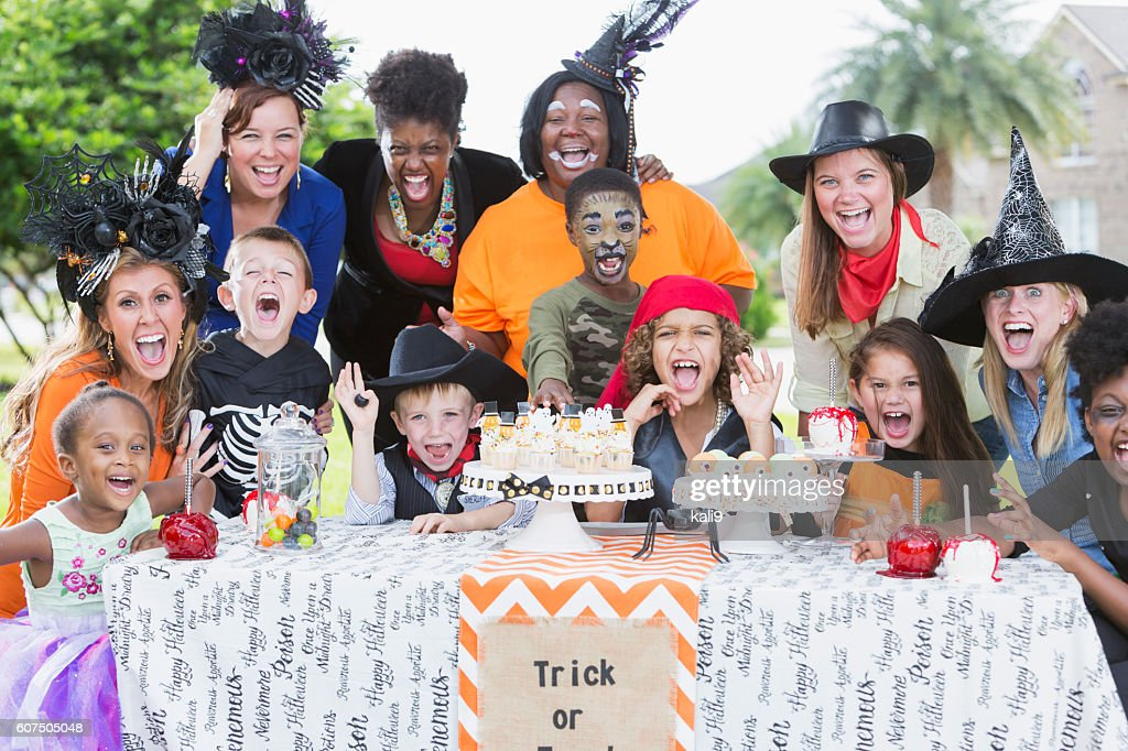 Group of mothers and children at Halloween party : Stock Photo