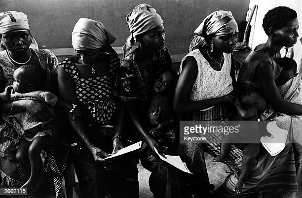 A group of mothers and their babies waiting at the Enugu Civilian Hospital Kwasiker Biafra during the famine resulting from the Biafran War