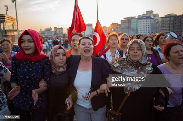 Group of mothers and young women march arm-in-arm through Taksim Square in protest against Gezi Park redevelopment plans.