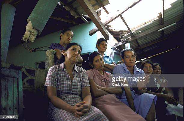 Group of mothers denouncing the civil war attacks and bombings while sitting in bombedout building in norhtern Amazon area of El Salvador