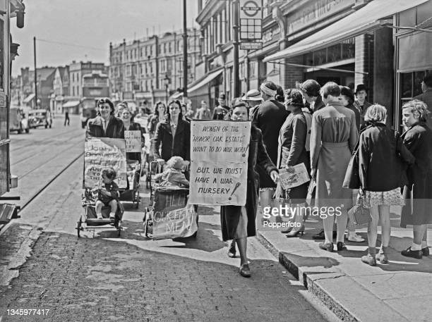 Group of mothers, some pushing babies and toddlers in prams, take part in a march to protest at the lack of nursery places in their local area of...