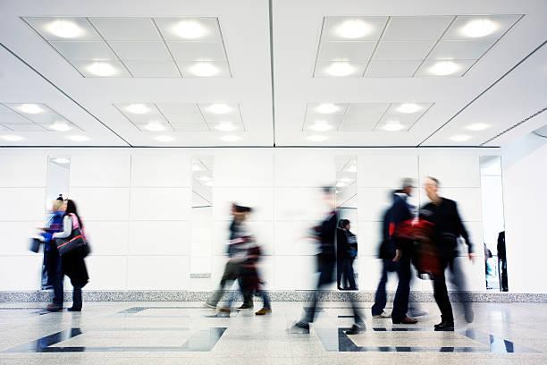 People Blur in Modern Corridor