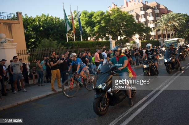 A group of motorcyclist from JUSAPOL pass front of protestors as they take part in a protest in support of national police officers and civil guards...