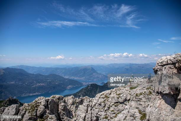 group of mountaineers on the mountain ridge - como italy stock pictures, royalty-free photos & images