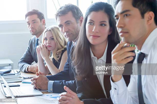 Group of multi ethnic business people listening.
