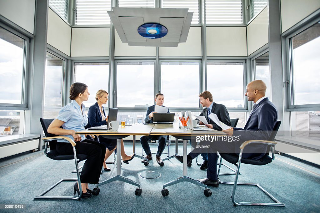 Group of multi ethnic executives in a meeting : Foto de stock
