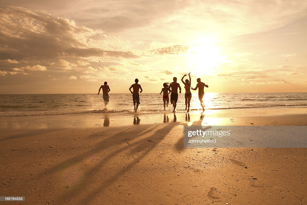 Group of multi ethnic friends having fun at the beach : Stock Photo