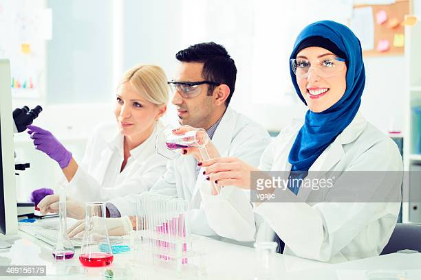 Group of multi ethnic scientists working in a lab.