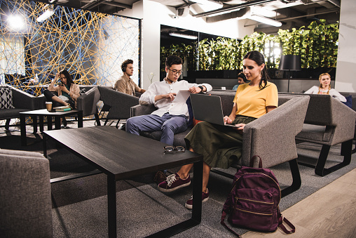 group of multicultural businesspeople working at modern coworking office 1041164100