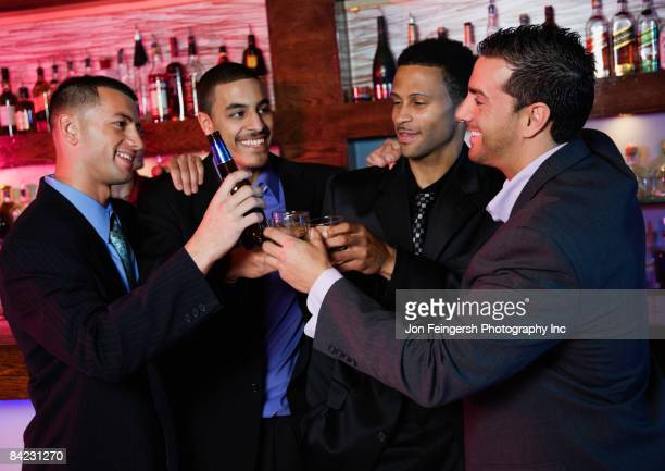 Group of multi-ethnic businessmen drinking in bar