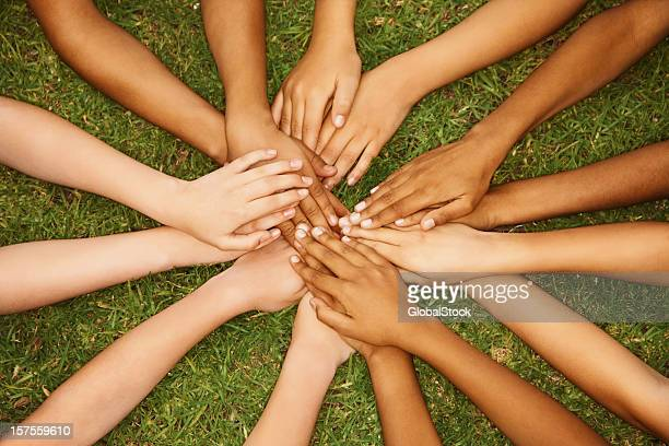 Group of multiethnic children with their hands together