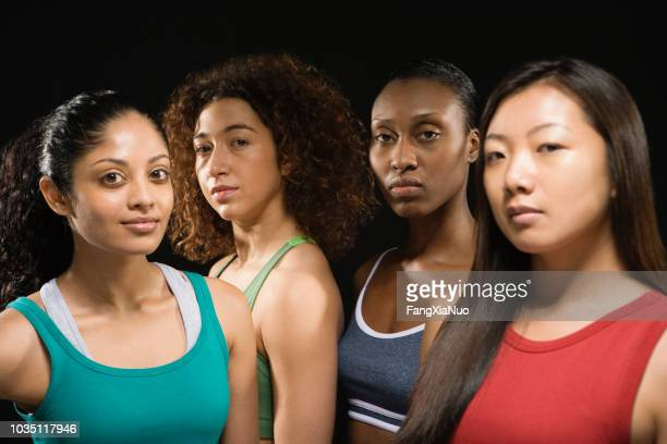 group of multi-ethnic female athletes - minority groups stock pictures, royalty-free photos & images