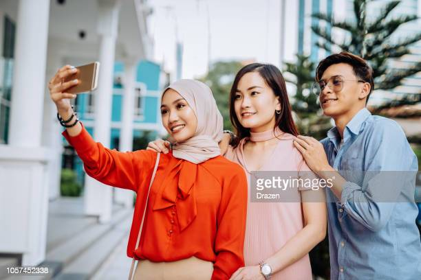 Group of multi-ethnic friends taking selfie for social networks in Asia