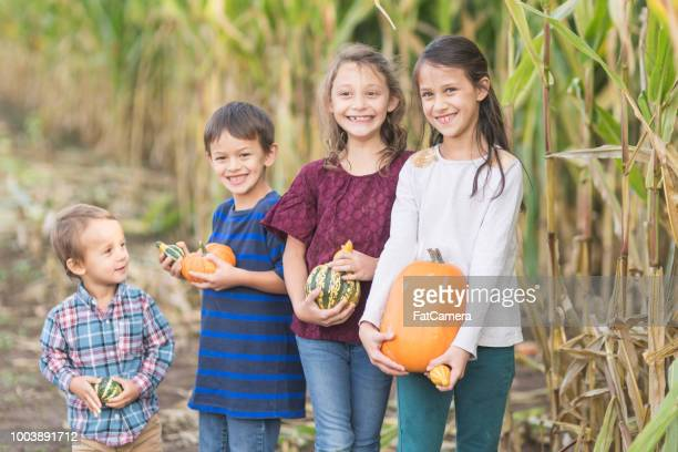 Group of multiethnic kids at a pumpkin patch
