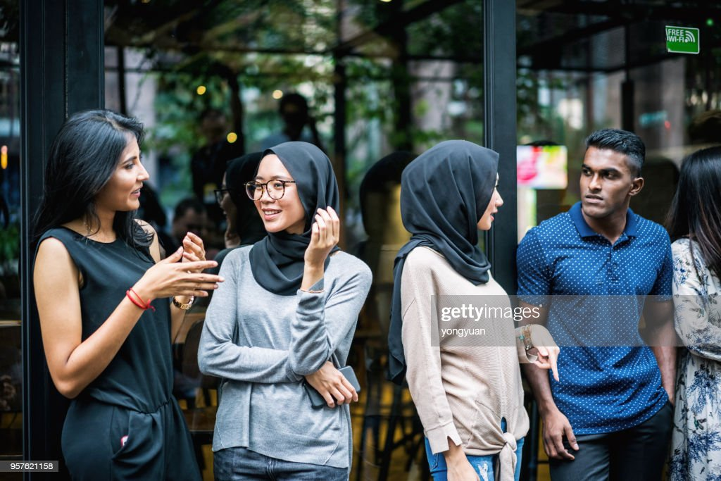 Group of multi-ethnic people having a talk : Stock Photo