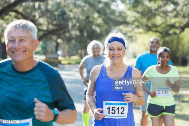 Group of multi-ethnic seniors running a race