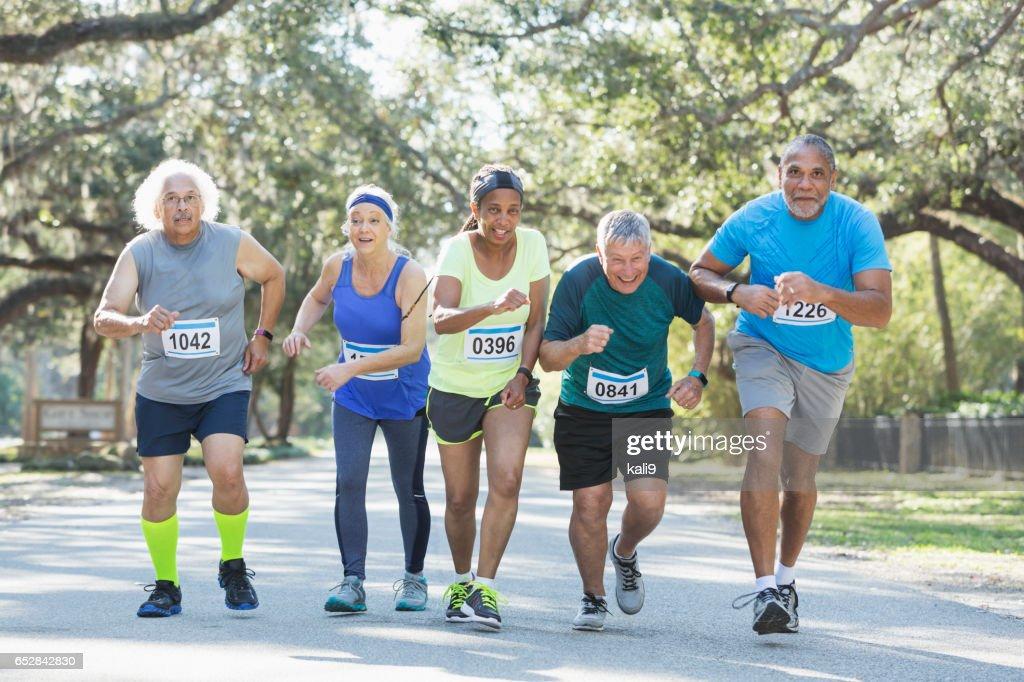 Group of multi-ethnic seniors running a race : Stock Photo