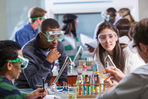 Group of multi-ethnic students in chemistry lab 469951129