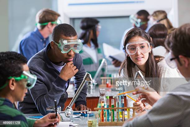 group of multi-ethnic students in chemistry lab - chemistry stock pictures, royalty-free photos & images