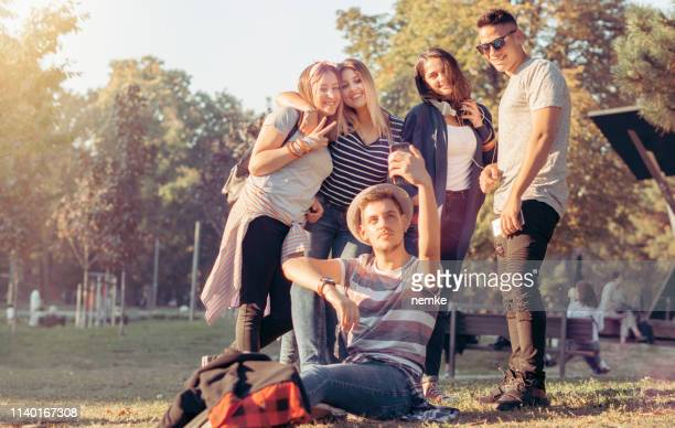 group of multiethnic teenagers taking a selfie - adulation stock pictures, royalty-free photos & images