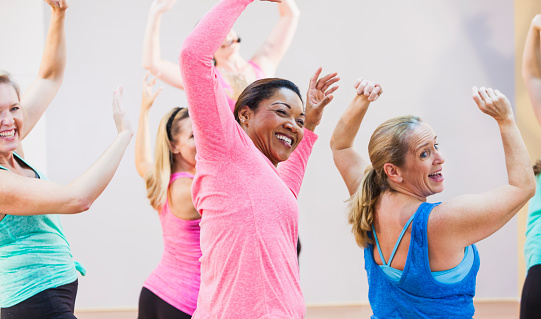 Group of multi-ethnic women in exercise class 509718676