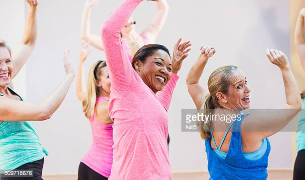 group of multi-ethnic women in exercise class - adult stock pictures, royalty-free photos & images