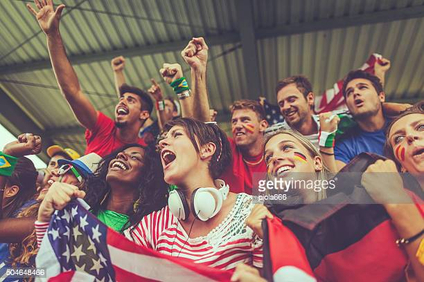 group of multiracial nations supporters together - sports team event stock photos and pictures