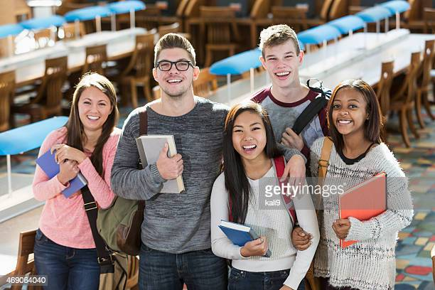 Group of multiracial teenage students in the library