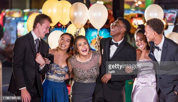 group of multi-racial teenagers having fun at prom - prom dress stock pictures, royalty-free photos & images