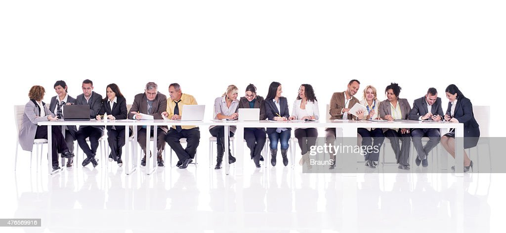 Group of multi-tasking business people isolated on white. : Stock Photo