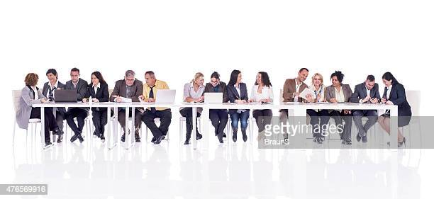 Group of multi-tasking business people isolated on white.