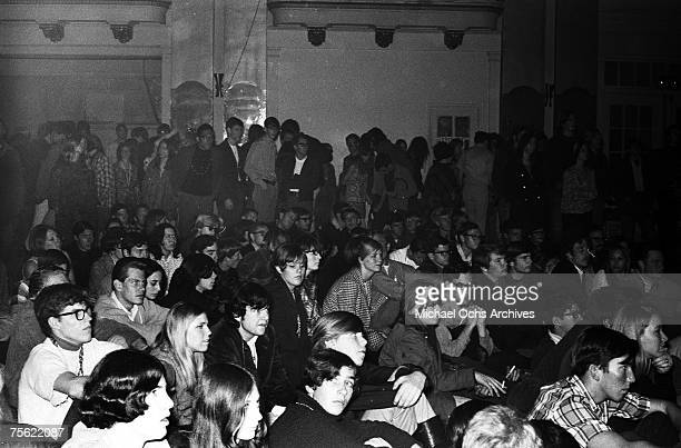 A group of music fans eagerly waits for a rock concert to start at the Fillmore Auditorium in San Francisco California in early summer 1967