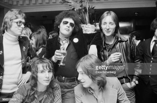 A group of music journlists and industry figures at an after show party at Burke's Restaurant in Mayfair London 1974 LR back are Chris Charlesworth...