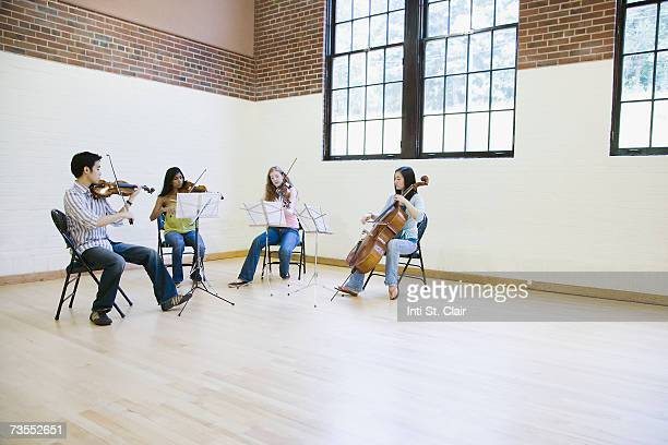 Group of musician rehearsing in music studio