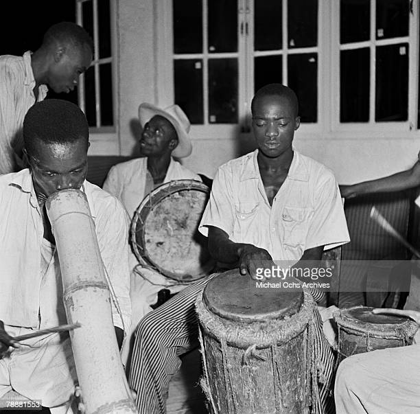 A group of musicians play a vaccine and drums at a party in 1946 in PortauPrince Haiti