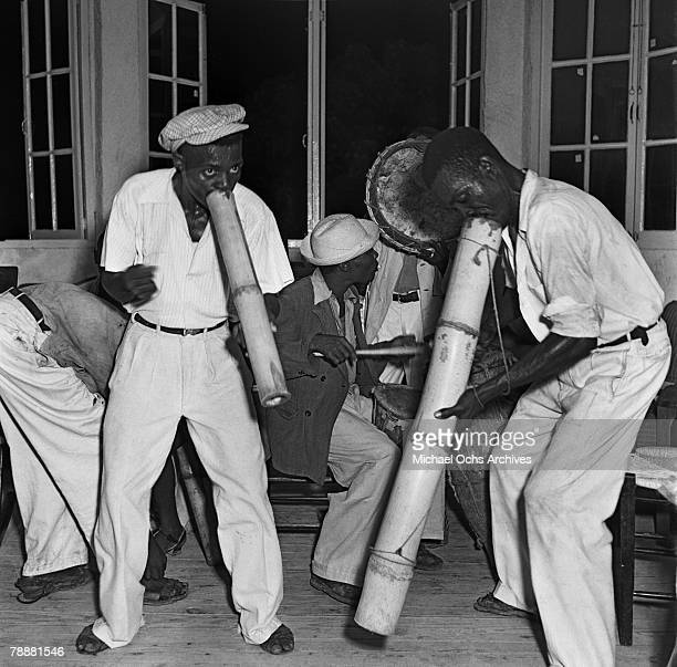 A group of musicians play vaccines and drums at a party in 1946 in PortauPrince Haiti