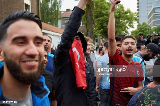 A group of muslim men cheer as antiislam group Pegida cancelled a planned barbecue on June 7 2018 in Rotterdam NetherlandsThe antiislam group Pegida...