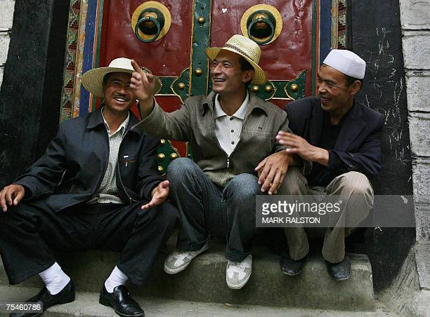A group of muslim men wait outside a mosque near Tibet's holiest shrine the 1300 year old Jokhang Temple in the Tibetan capital Lhasa 07 July 2006...