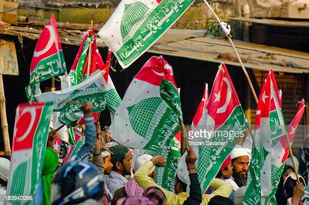 CONTENT] Group of Muslim men waving green flags depicting Islamic symbols at the Milad unNabi street parade This is the celebration of...
