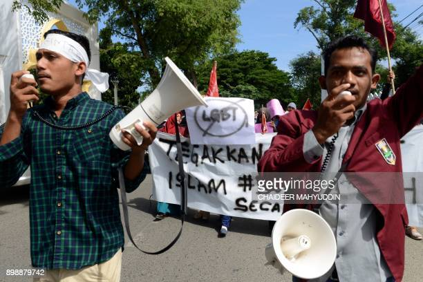 A group of Muslim protesters march with banners against the lesbian gay bisexual and transgender community in Banda Aceh on Decmber 27 2017 There has...
