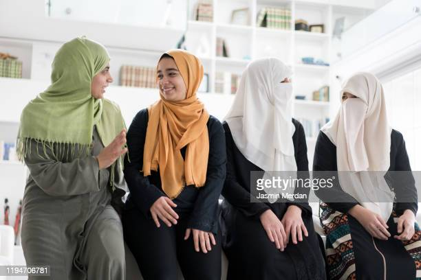 group of muslim women and girls at home - nikab stock pictures, royalty-free photos & images