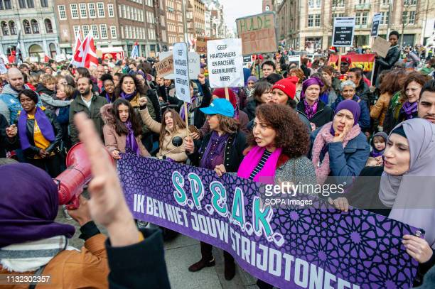A group of Muslim women are seen screaming slogans during the demonstration Thousands of people gathered at the Dam square in the center of Amsterdam...