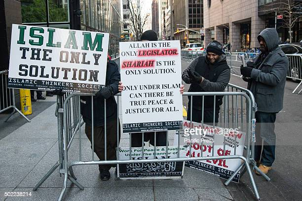 A group of MuslimAmerican men advocating for Shariah law rally apart from the larger demonstration insisting that the aims of the demonstrators are...